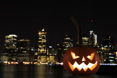 Scary Halloween's pumpkin. Scary pumpkin, symbol of Halloween, waiting for a celebrate on the shores of Brooklyn, against Manhattan Island, New York, United stock images