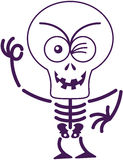 Scary Halloween Skeleton Winking And Making An OK Sign Royalty Free Stock Images