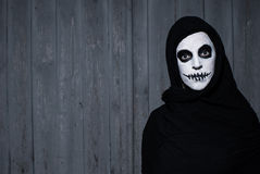 Scary halloween skull woman. With grey wooden background royalty free stock image