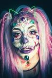 Scary halloween woman closeup studio shot. Scary halloween woman with sugar skull makeup closeup studio shot stock photos