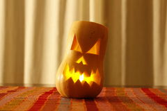 Scary hallowen face carved in a pumpkin Royalty Free Stock Photography