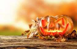Scary hallowen pumpkin on wood Royalty Free Stock Images
