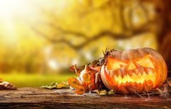 Scary hallowen pumpkins on wood Stock Image