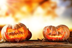 Scary hallowen pumpkins on wood Royalty Free Stock Photography