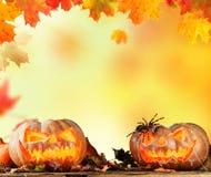 Scary hallowen pumpkins on wood Royalty Free Stock Photo