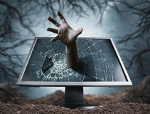Scary hand sticks from computer Stock Photos