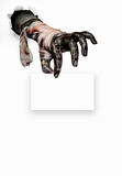 Scary hand. Zombie hand holding a  white paper on white .Halloween concept Stock Photo