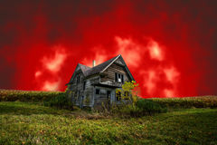 Scary Haunted Halloween House With Evil Red Sky Royalty Free Stock Images
