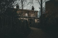 A scary haunted house stock images