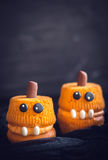 Scary pumpkin cup cakes. Scary homemade pumpkin cup cakes,halloween decoration Stock Photos