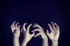 Scary horror hand on the darkness on a black background with cop. Y space Royalty Free Stock Images