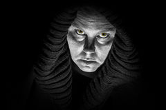 Scary Horror Lady. A scary, ugly lady wears a black shroud; glowing monster eyes; black and white image Stock Images