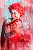 Scary hospital clown cleaning blood smeared window. Pane in hospital surgical ward Royalty Free Stock Photos