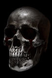 Scary human skull side view, blood tears Royalty Free Stock Images