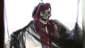 Scary human skull with scarves. Of Halloween waving in the wind stock video footage
