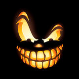 Scary Jack O Lantern. Close up of Scary Jack O Lantern in the dark Stock Photos