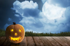 Scary Jack O Lantern with candle inside on the wooden floor Stock Image