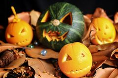 Scary Jack O Lantern halloween pumpkin. On dry leaves Royalty Free Stock Photos