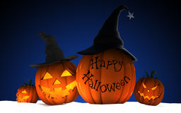 Scary Jack O Lantern halloween pumpkins wearing black witch hat Royalty Free Stock Image