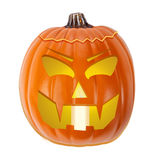 Scary Jack-O-Lantern Pumpkin. Jack-o-Lantern carved pumpkin with a scary expression, illuminated with a lit candle Royalty Free Stock Photo