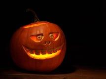 Scary jack o lantern pumpkin composition Stock Photos