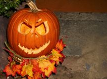 A scary Jack O Lantern. A spooky Halloween Jack O Lantern carved out of a pumpkin awaiting All Hallows Eve Royalty Free Stock Photography