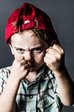 Scary kid with freckles and hat back boxing and bullying Royalty Free Stock Photo