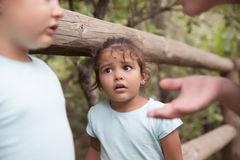 Scary kid looking at sister and mother having quarrel Royalty Free Stock Image