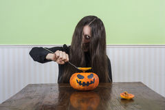 Scary lady eating pumkin soup Stock Photography