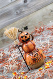 Scary large orange pumpkin ceramic figure on old wood Stock Image
