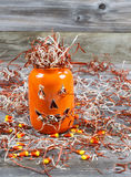 Scary large orange pumpkin ceramic jar on rustic wood Stock Images