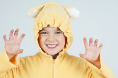 Scary little girl bear. Cute little girl in teddy bear costume making scary face Royalty Free Stock Photos