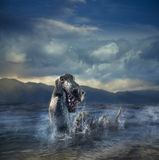 Scary Loch Ness Monster emerging from water Royalty Free Stock Image