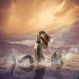 Scary Loch Ness Monster emerging from water Royalty Free Stock Photos