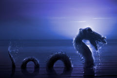 Scary Loch Ness Monster emerging from water. Photo composite: Loch Ness Monster at night Royalty Free Stock Photography