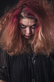 Scary looking woman with red hair Royalty Free Stock Images