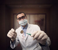 Scary mad dentist Royalty Free Stock Photos