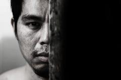 scary man hide behind wooden door Stock Photo