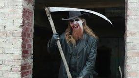 Scary man killer. Scary killer man, holding a scythe in his hand to kill stock video