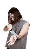 Scary man with knife attempting suicide Royalty Free Stock Photos