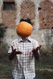 Scary man playing with a pumpkin Royalty Free Stock Image