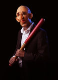 Scary man in suit with mask and baseball bat Royalty Free Stock Photography