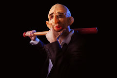 Scary man in suit with mask and baseball bat Royalty Free Stock Photos