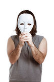 Scary man with white mask. Scary man holding white mask, isolated on white background royalty free stock photography