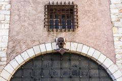 Gates with a scary mask royalty free stock image