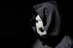 Scary masked man Stock Photo