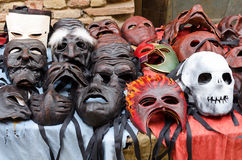 Scary masks. Over the table of the shop stock photography