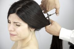 Scary moment long hair being cut by hairdresser Stock Photos