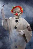 Scary monster clown. With hammer Royalty Free Stock Image