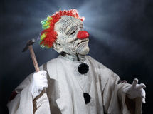 Scary monster clown. With hammer Royalty Free Stock Images